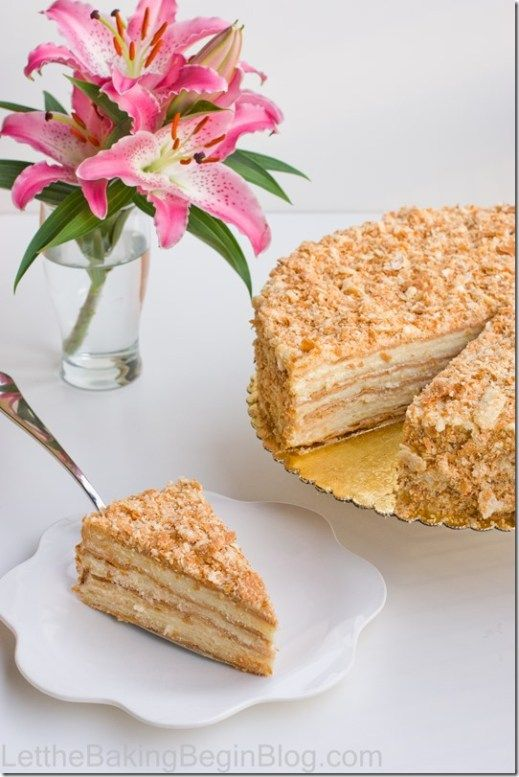 Homemade puff pastry sheets in between layers of custard cream. This homemade Napoleon Cake is a classic Russian dessert. #napoleonkuchenrussisch