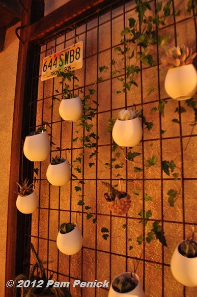 Vertical Metal Grid With Hanging Quot Egg Quot Planters Filled