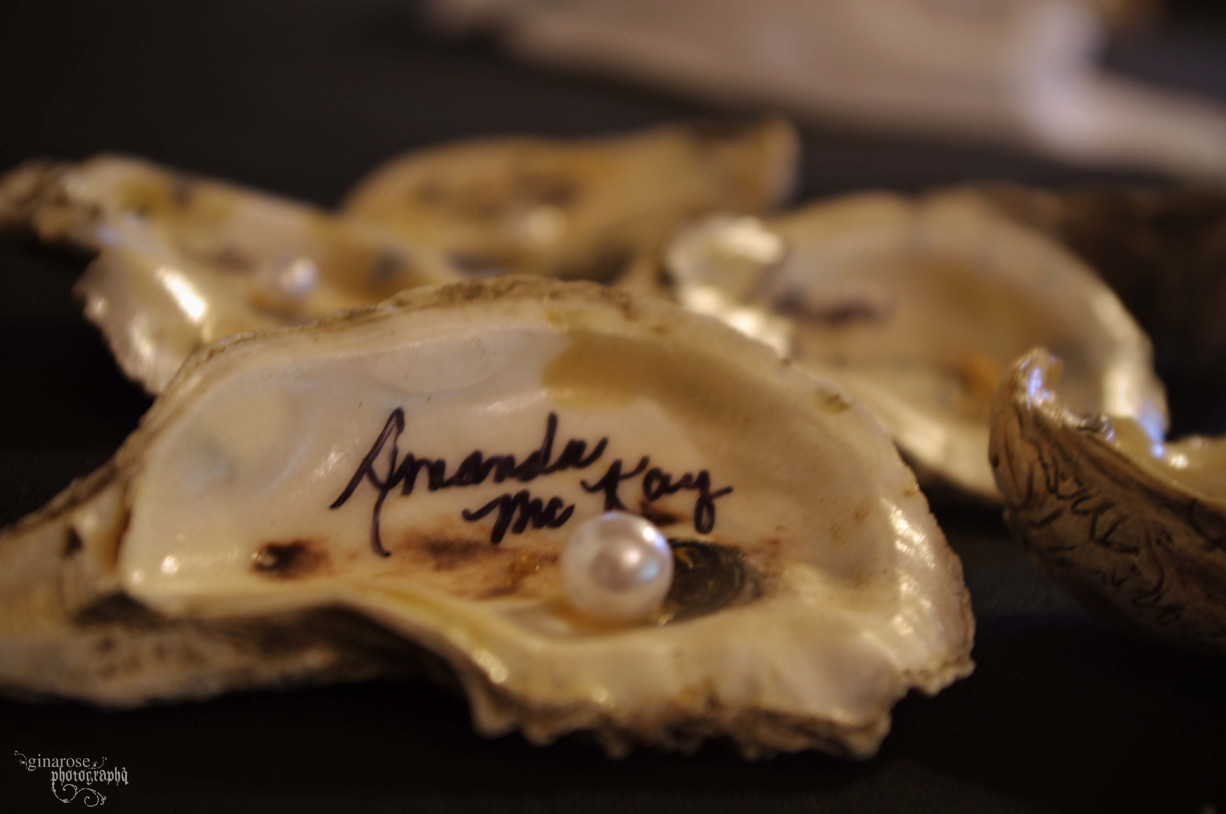 Names On Oyster Shells For Assigned Seating At A Wedding Reception