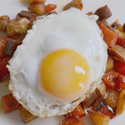 Delia's Fried eggs on chorizo hash