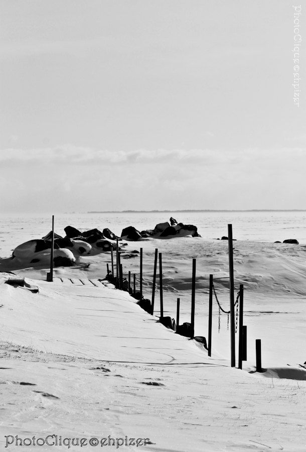 Deserted pier black white bw winter snow landscape fine art photography print photographed along the shoreline of lake ontario one of the great