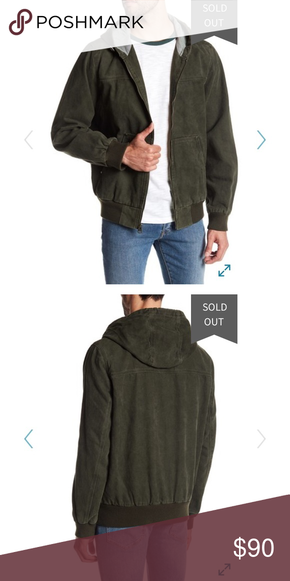 """New With Tags Levi's Hooded Canvas Jacket XL Brand New color Olive size XL Men  Details - Attached hood - Long sleeves - Front zip closure - 2 front slip pockets - 1 interior pocket - Rib knit cuffs and hem - Approx. 28"""" length (size M) - Imported Fiber Content Shell: 100% cotton Back body/Hood lining: 52% cotton, 48% polyester Front body lining: 100% cotton Sleeve lining: 100% polyester Knit: 99% polyester, 1% rubber Care Machine wash Levi's Jackets & Coats"""