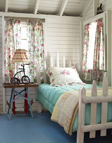 Tony Shalhoub & Brook Adams ~ Martha's VIneyard beach cottage - love this guest room with the floral curtains and picket fence bed dressed in soothing colors and prints.