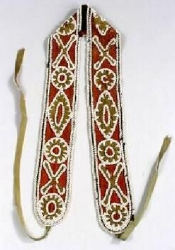native american, America, Southeast beaded cloth sash, probably Choctaw, mid 19th century, the red trade cloth sash with green cloth geometric appliques and blue cloth border, the cloth parts elaborately edged in white pony beads, green cloth ties at each end.