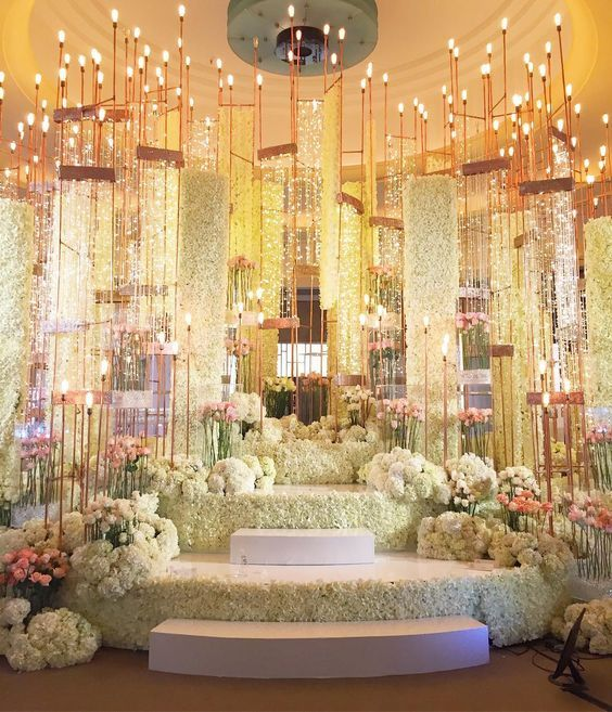 This Stage Decor In All White Is So Beautiful White Flower Decor White Carnations Wedding Flower Decorations Wedding Decorations Indian Wedding Decorations