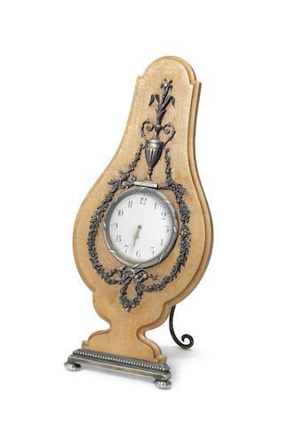 A parcel gilt and wooden clock in the Louis XVI tasteFaberge, workmaster Viktor Aarne, St. Petersburg, 1897, scratch inventory number 56756