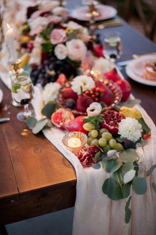 Fruit Wedding Decor Idea Draped Fabric With Fresh Grapes Pears And Pomegranates Sassy Sn Pomegranate Wedding Fruit Centerpieces Table Arrangements Wedding