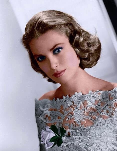 Grace Kelly dressed in a magnificent ice blue dress, which makes her blue eyes look even bluer!!
