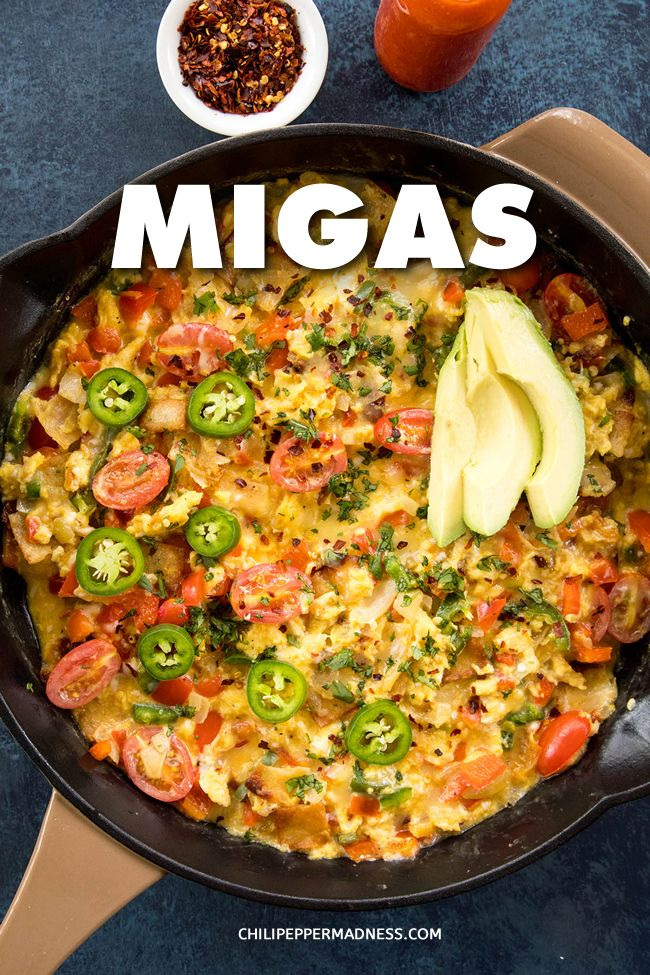 mexican breakfast #breakfast A quick and easy recipe for Migas, which are lightly scrambled eggs with crispy tortillas, jalapeno peppers, tomato and melted cheese. Truly NOM NOM. #MexicanBreakfast #Breakfast #ScrambledEggs