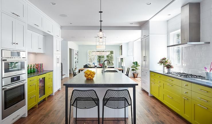 contemporary white and citron yellow kitchen is lit by clear glass pendants hung over a white i on kitchen interior yellow and white id=58711