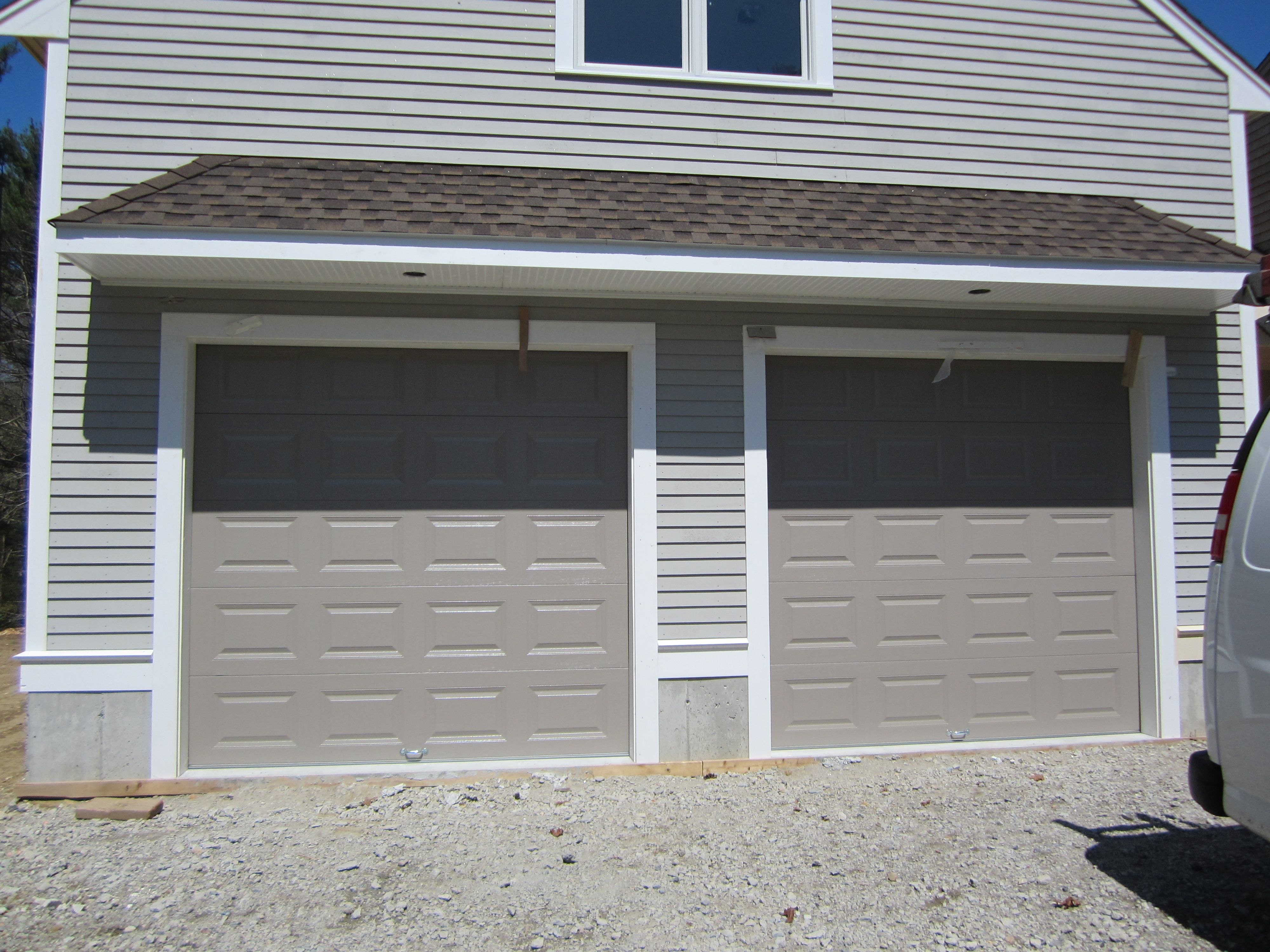 Classica northampton garage door white 9 x 8 no windows - Haas Model 680 Steel Raised Panel Doors In Sandstone Installed By Mortland Overhead Door