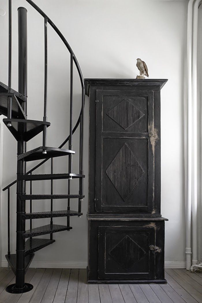 Vintage minimalist black and white spiral staircase.