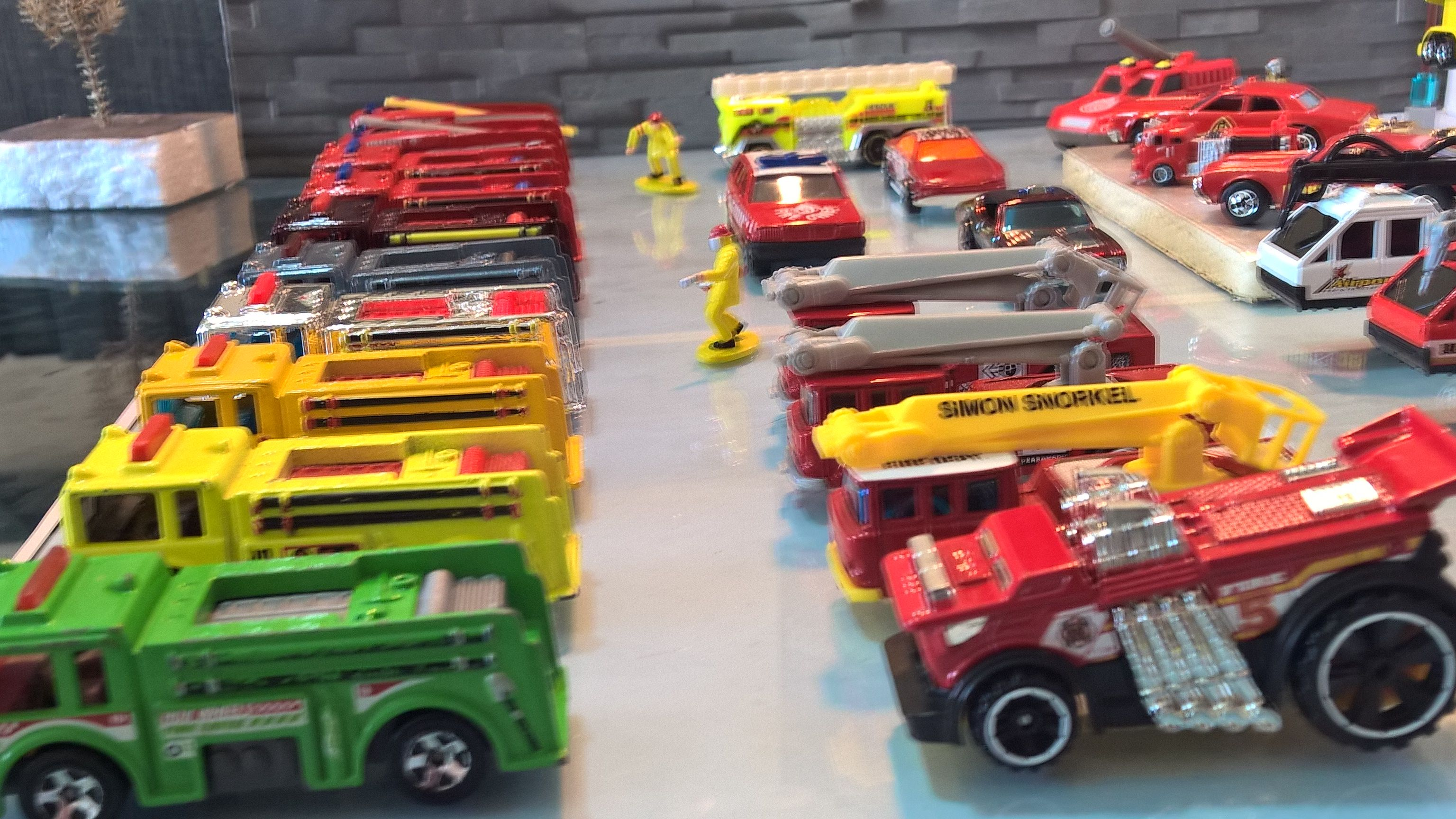 Organized Hot Wheels Monster Trucks Collection Using 97 Curtain