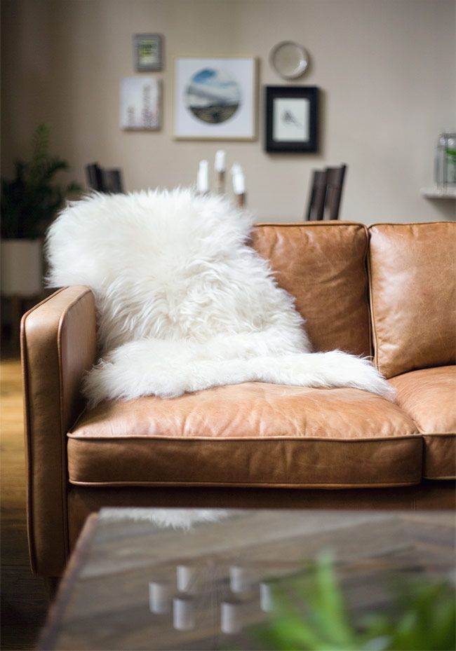 Distressed Leather Sofa With Sheepskin Throw