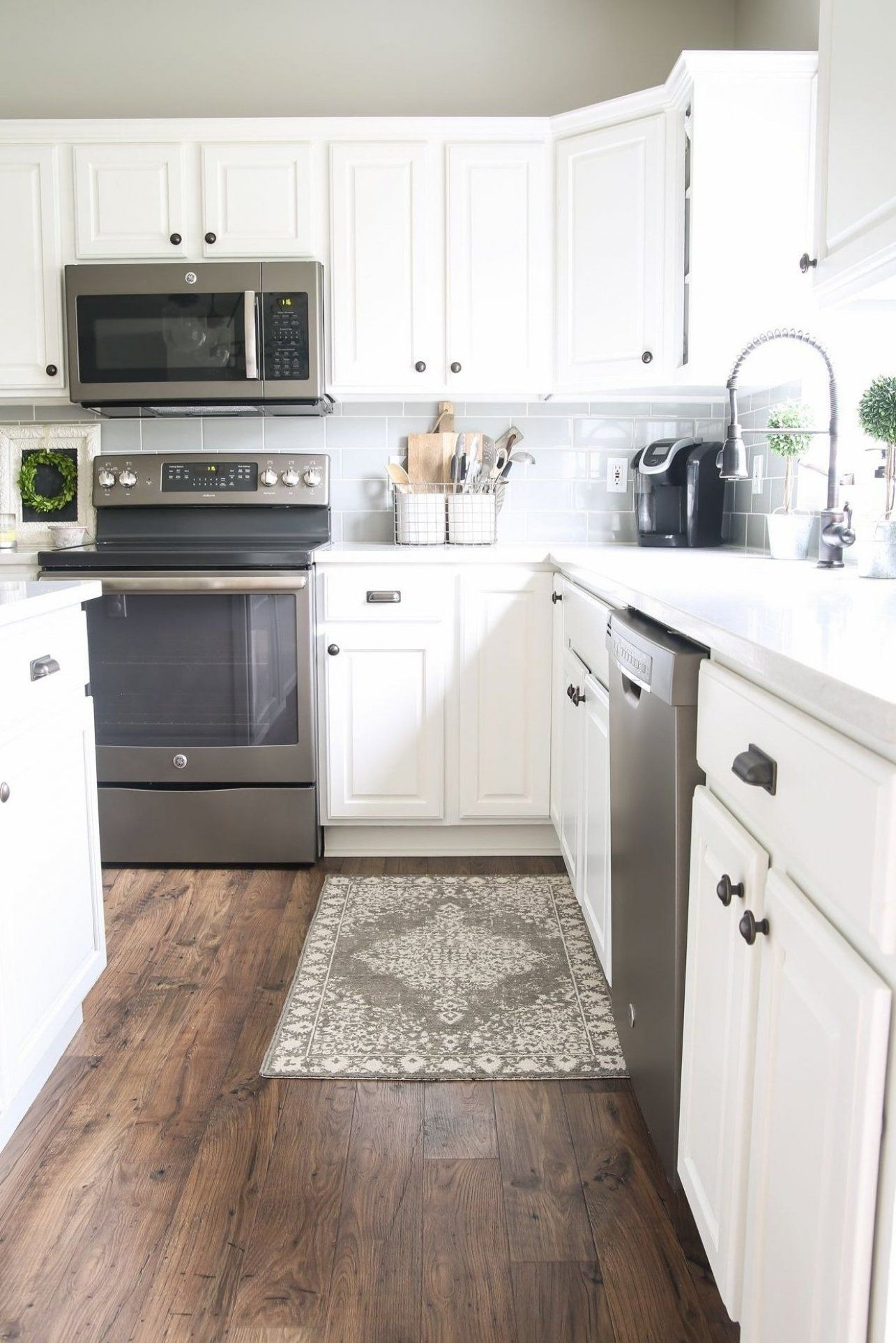 How Our Laminate Floors Are Holding Up Via House By Hoff In 2020 Wood Laminate Flooring Kitchen Cabinets Decor Laminate Kitchen Cabinets