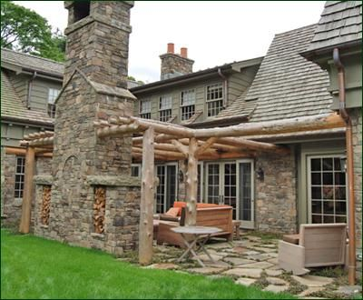 rustic patio pergola an outdoor room reminiscent of a log cabin is created by the - Rustic Patio Ideas