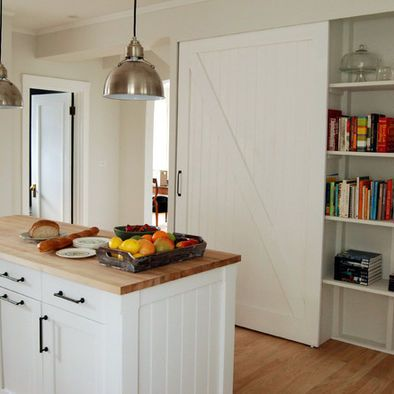 Doors left natural instead of white, with white cabinets and soapstone counters.