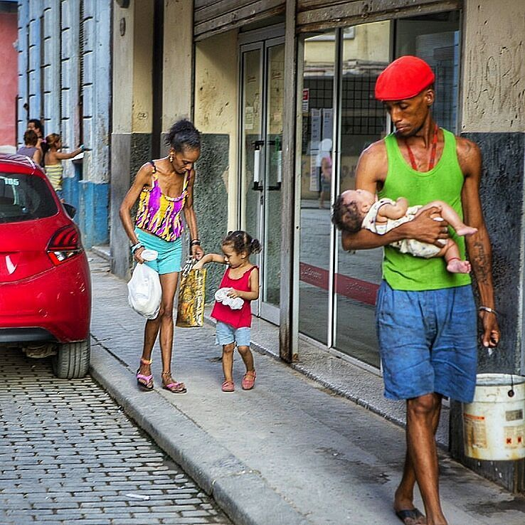 Cuban family the look this father is giving his baby just melts my heart. Caught in the moment #bless #Havana #Cuba #Habana #colour #vibrant #city #streetphotography #candid #capture #streetsnap #familia #baby by imagerybyjasmina