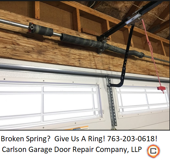 Broken Garage Door Spring In The Twin Cities Area Give Us A Ring 763 203 0618 We Service The E With Images Garage Door Repair Broken Garage Door Affordable Garage Doors