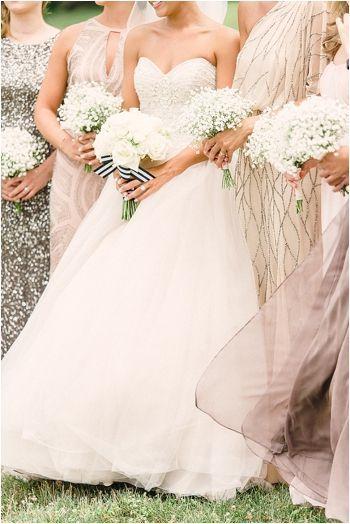 Bridesmaids in blush, sparkle + baby's breath
