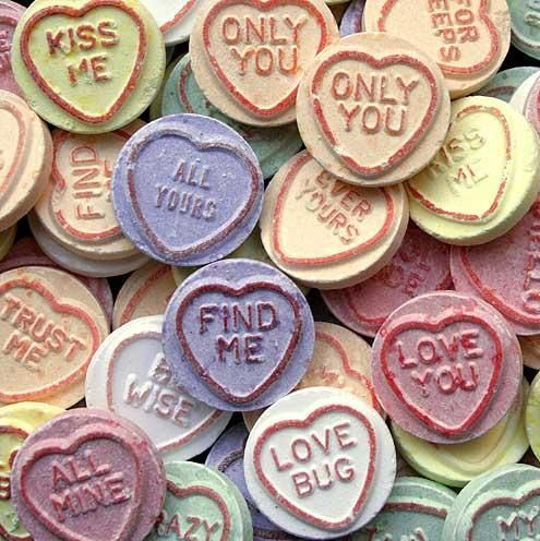 Love heart sweets, only with lonely phrases, opposite of what they are like the lonely hearts ads