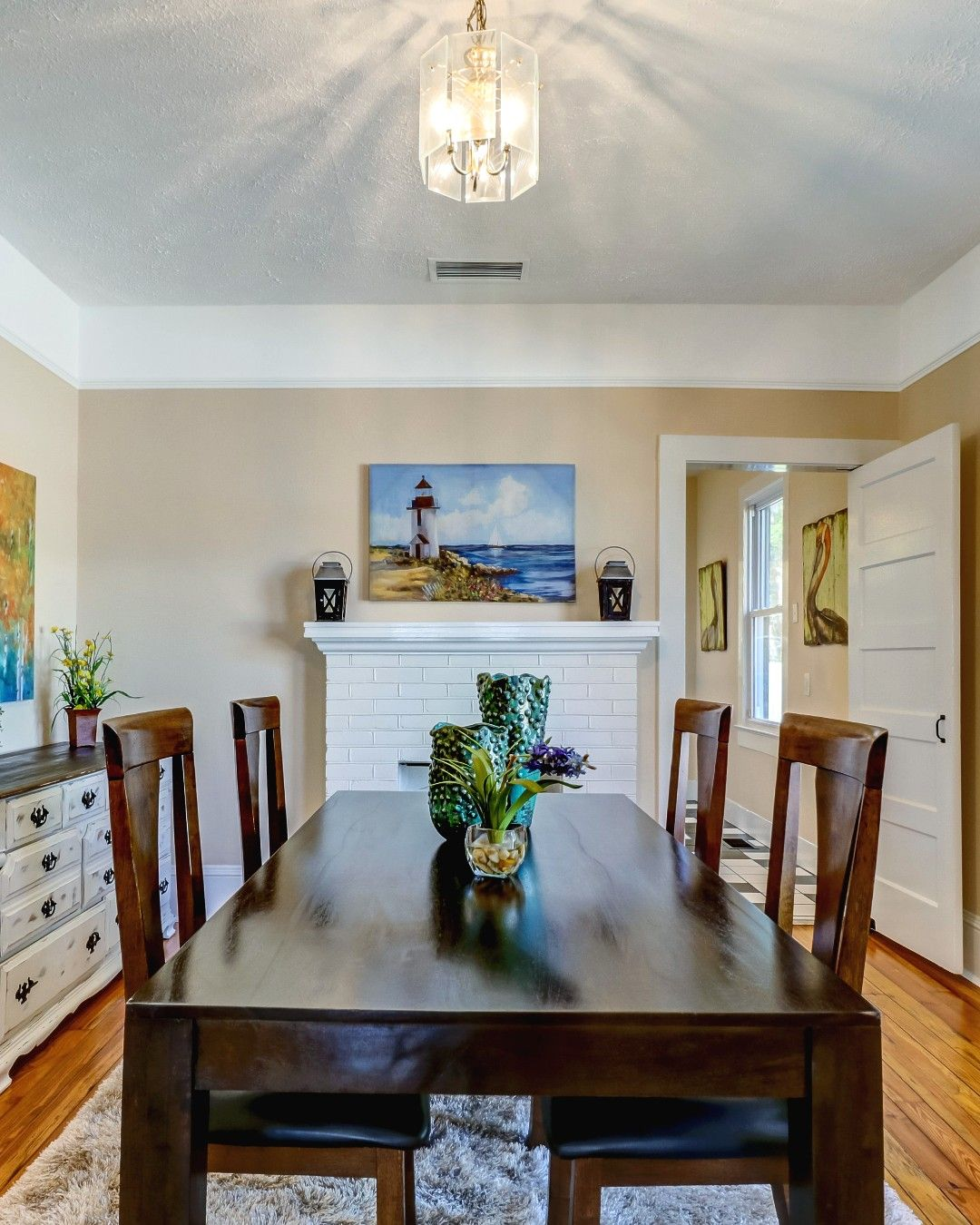Home Staging Dining Room Table: A Coastal Feel 🌊🦀 #lighthouse #floridaliving #diningroom