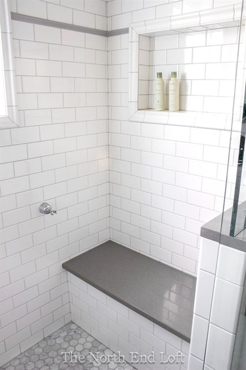 We chose shiny white subway tile with light gray grout for the walls, with an accent line of gray tile. #GreyAndWhiteBathroom #whitesubwaytilebathroom