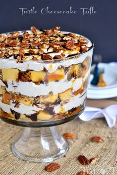 This Turtle Cheesecake Trifle is filled with layers of caramel, chocolate, pecans, no bake cheesecake, and delicious pound cake!