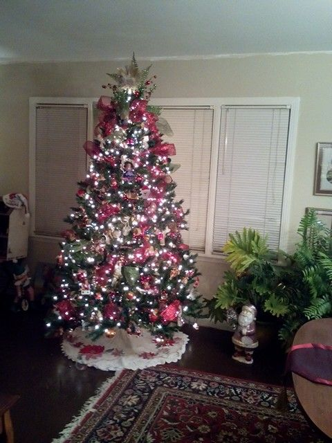 White lights and antique ornaments along with hand made from the children over the years...