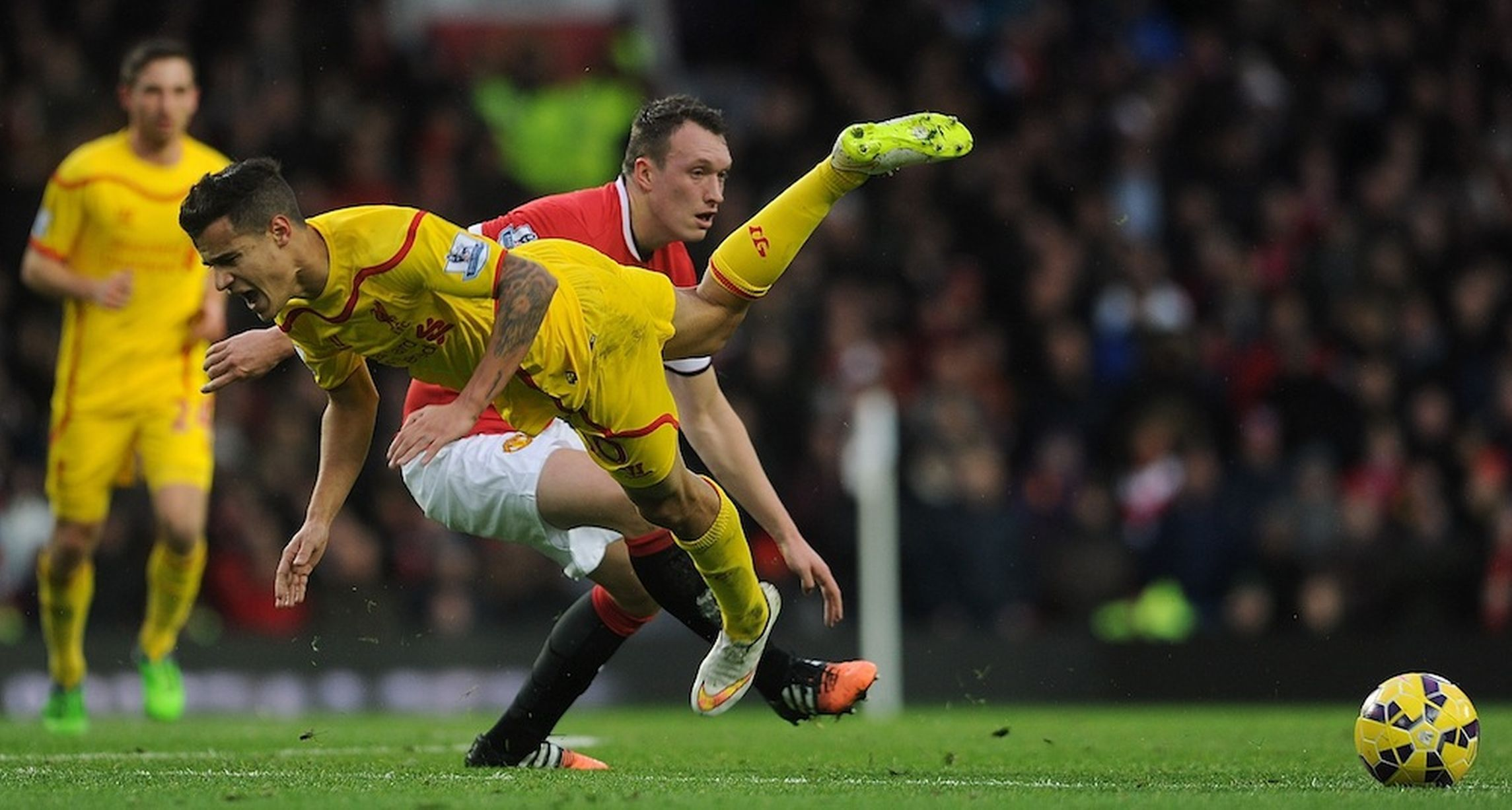 Philippe Coutinho of Liverpool is brought down by Phil Jones of Man United