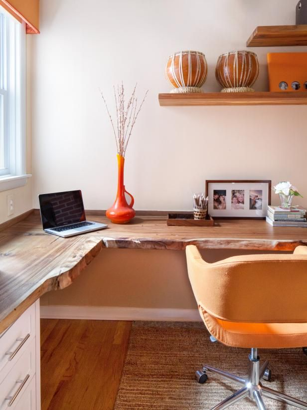 See the reclaimed wood corner desk in this contemporary home office with  orange accents on HGTV - See The Reclaimed Wood Corner Desk In This Contemporary Home