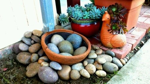 """""""Nest"""" drain I made with stones from my yard and a broken flower pot."""