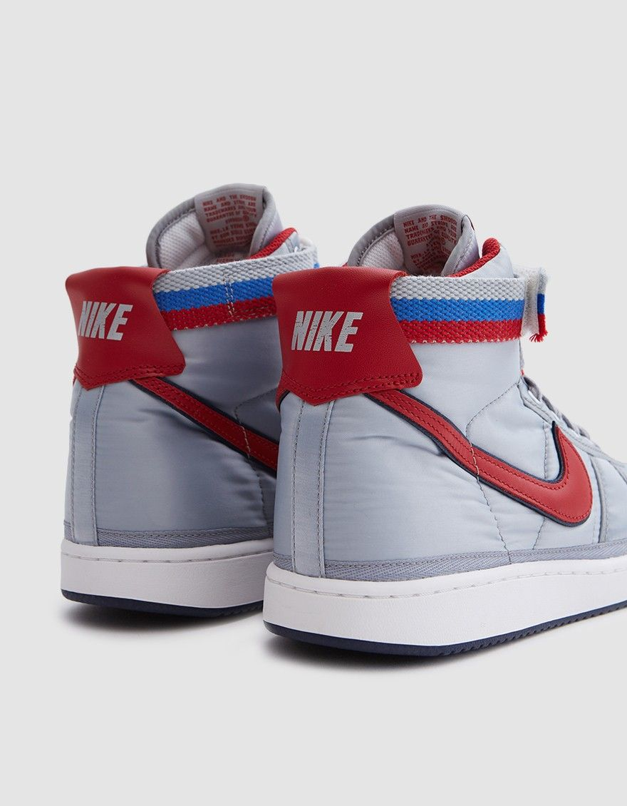2c46a3179981 Classic high top sneaker from Nike in Metallic Silver. Nylon upper. Lace-up  front with flat woven laces. Padded collar. Removable