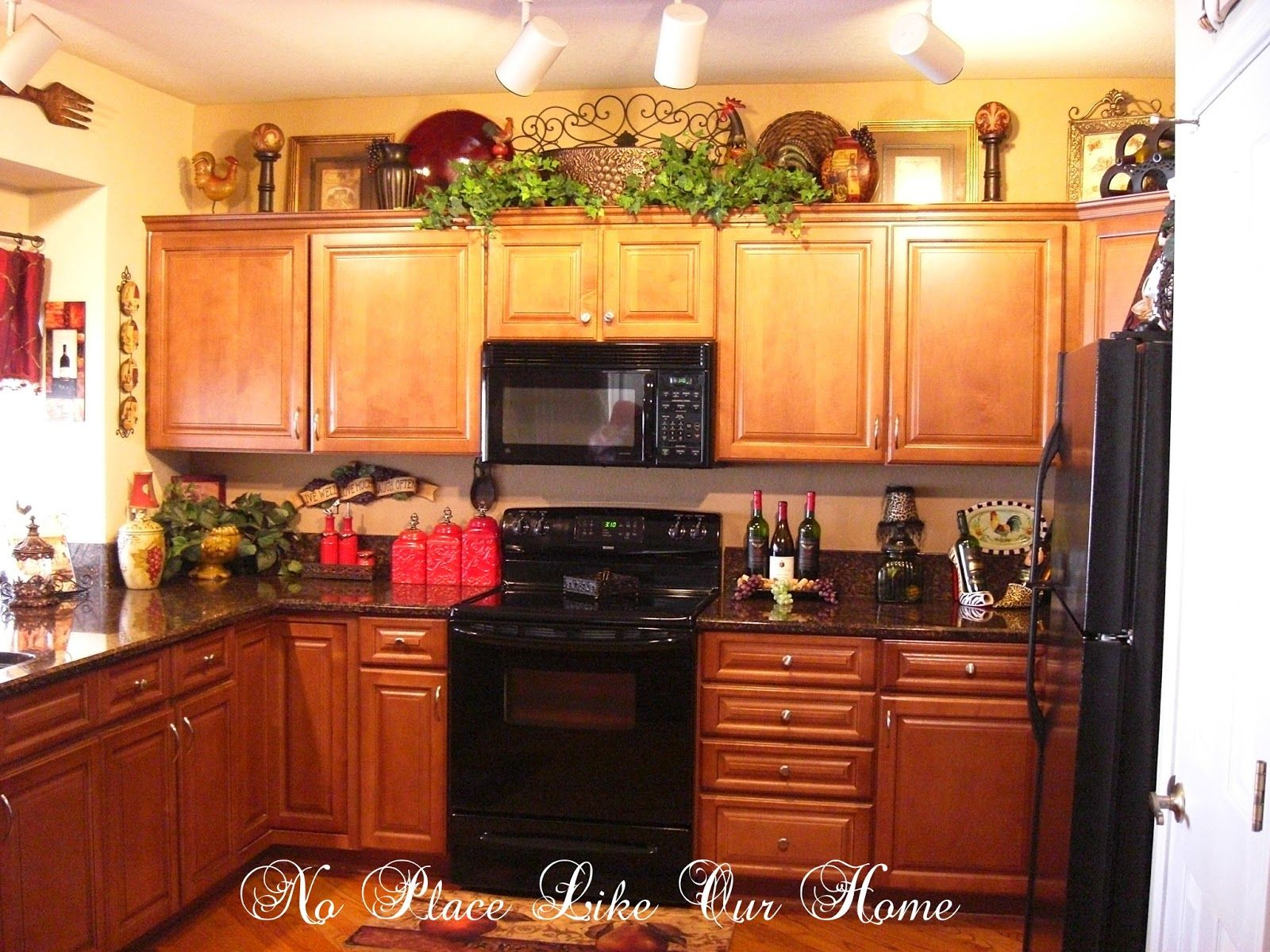 Decorating above kitchen cabinets tuscany heres a closer look at the top of the cabinets everything you see