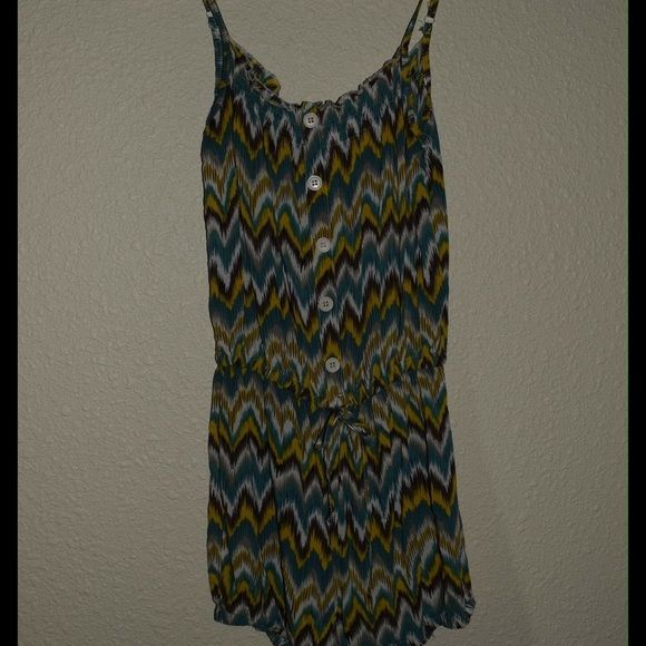 Patterned romper Super cute Aztec patterned romper by Aviva. Adjustable straps tie detail for best fit. Teal yellow browns and cream. So cute!! Excellent used condition no stains rips or holes. Aviva Pants Jumpsuits & Rompers