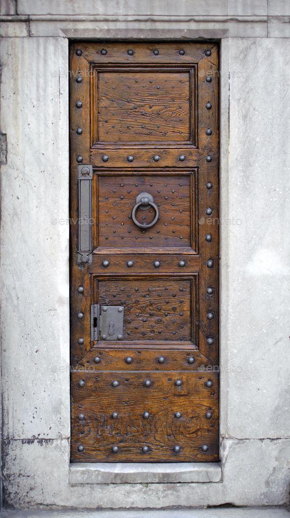 Photo of Antique wooden door by sergeyskleznev. Antique wooden door, metal knocker, rivet…