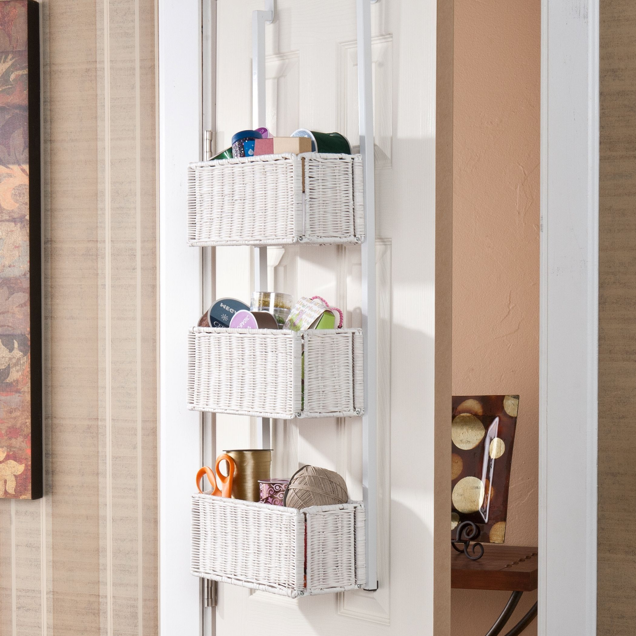 Add functional style to your room with this white-rattan, three-tier basket. Featuring over-door hooks to hang comfortably over most doors, this basket storage is perfect for organizing your belongings to help keep clutter to a minimum.