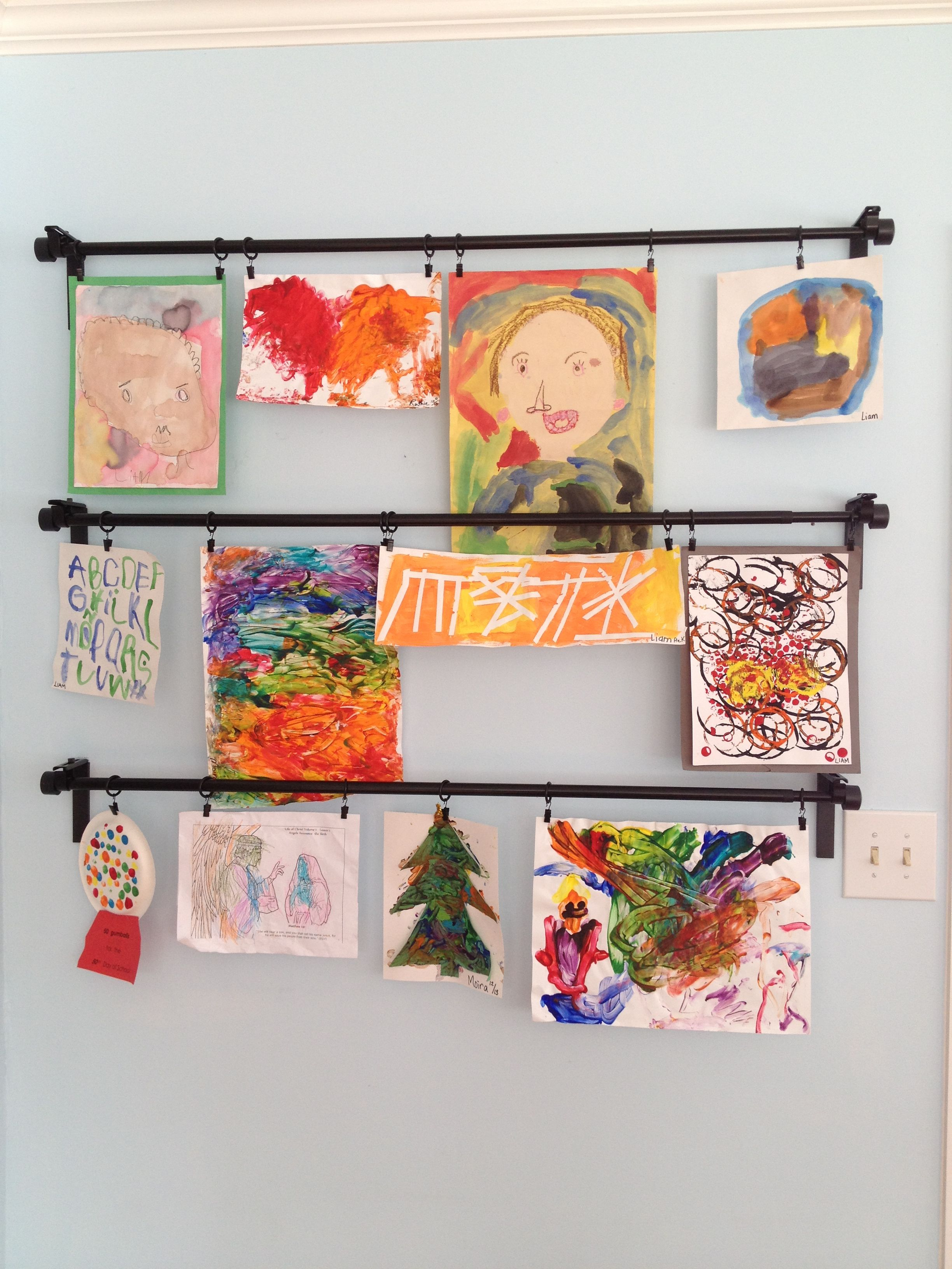 Children 39 s art displayed with ikea curtain rods craft for Curtain display ideas