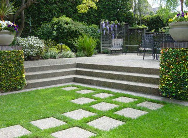 Exposed Aggregate Concrete Pavers Traverse The Lawn To Raised Concrete Patio  In This Piedmont Back Yard