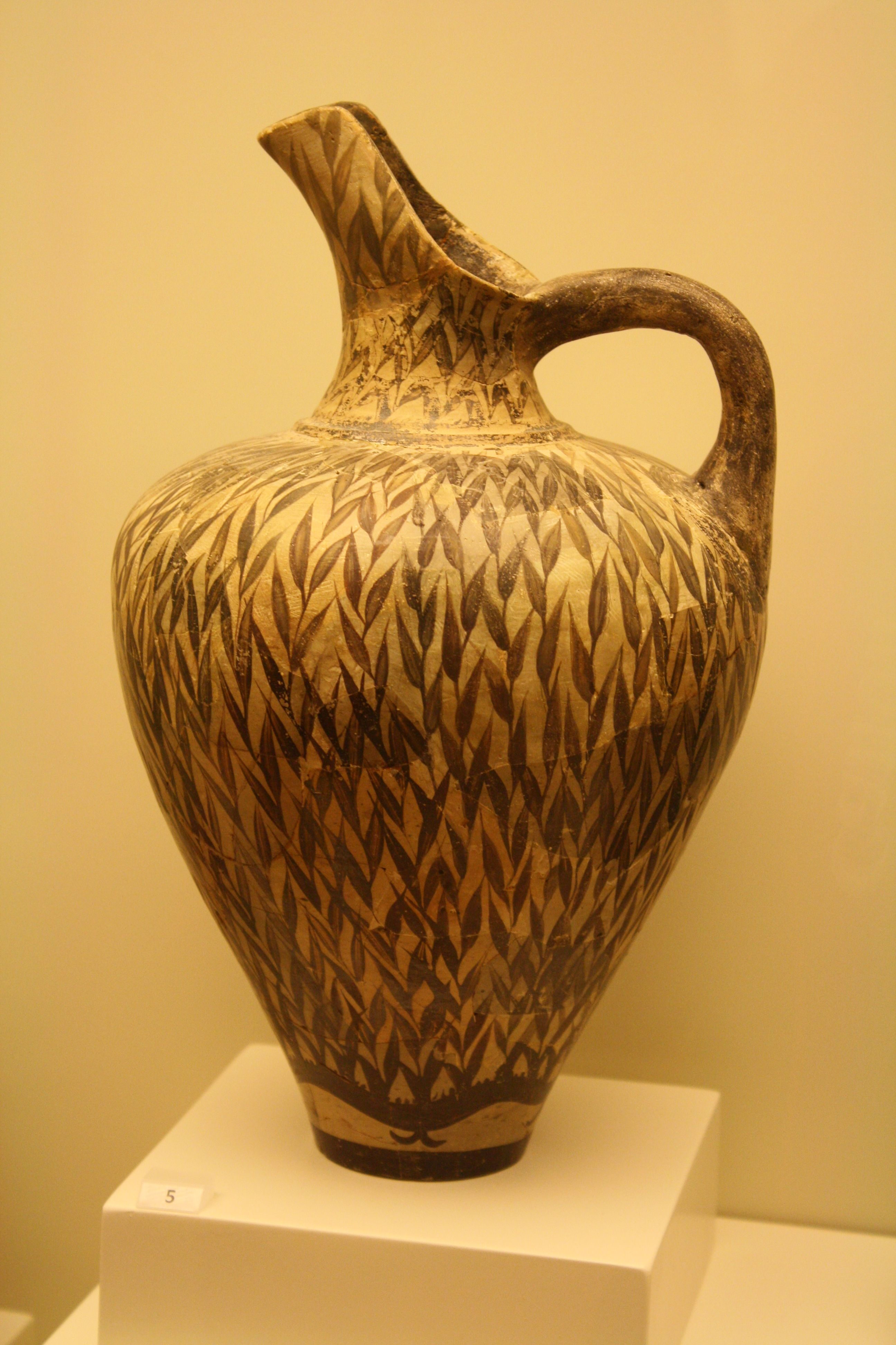 Minoan pottery is considered to have reached its zenith early, in the  Middle Minoan ... Floral Style ' Jug of the Reeds'