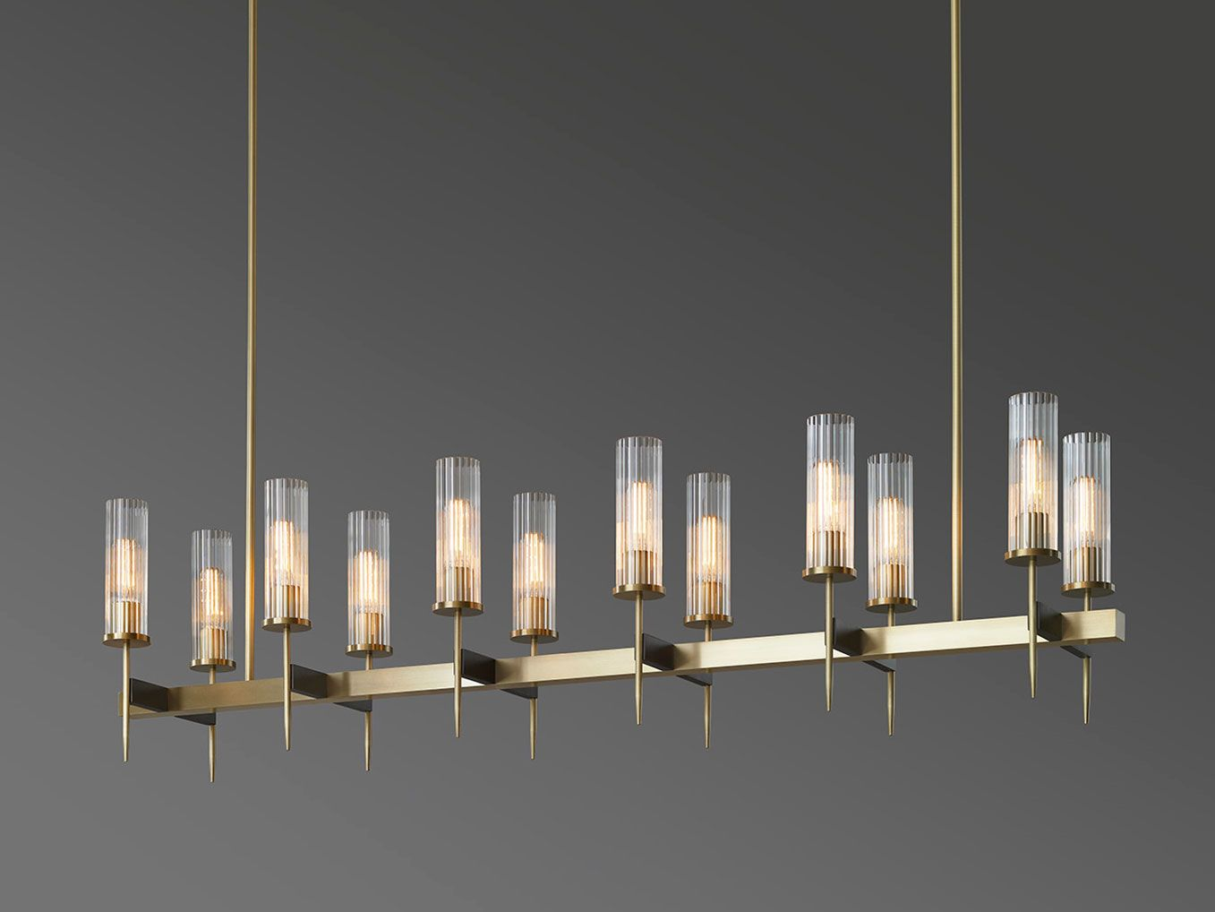 Jonathan browning studios alouette chandelier love i lighting metro lighting multi light pendant constructed from brass in an antique finish with clear contorax glass cylinder shades wired 12 x arubaitofo Gallery