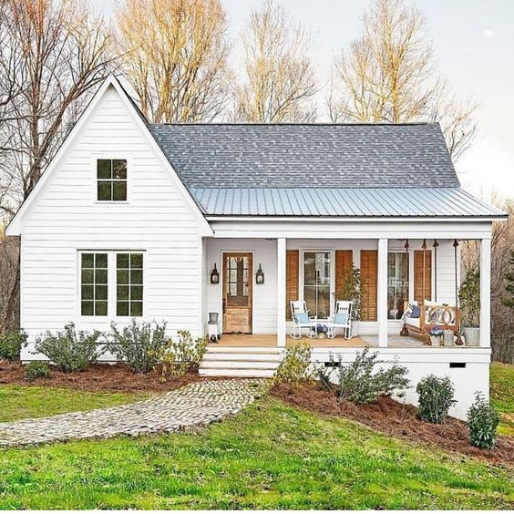 The perfect white house -- love the natural wood accents. Modern farmhouse, metal roof, front porch living. #houseideas