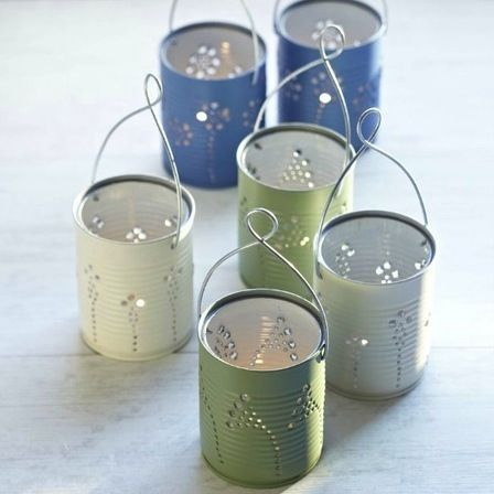 This is a photo craft tutorial on how to make Tin Can Lanterns using tin cans. Stencils wrapped around and holes punched into the cans make cool lanterns.