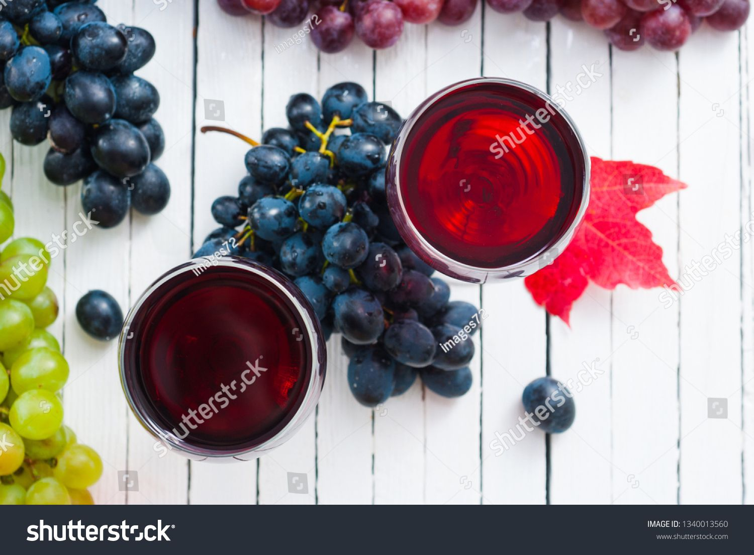 Two Glasses Of Red Wine And Grapes On White Wooden Table Background Ad Ad Wine Grapes Glasses Red In 2020 Grapes Red Wine Wine