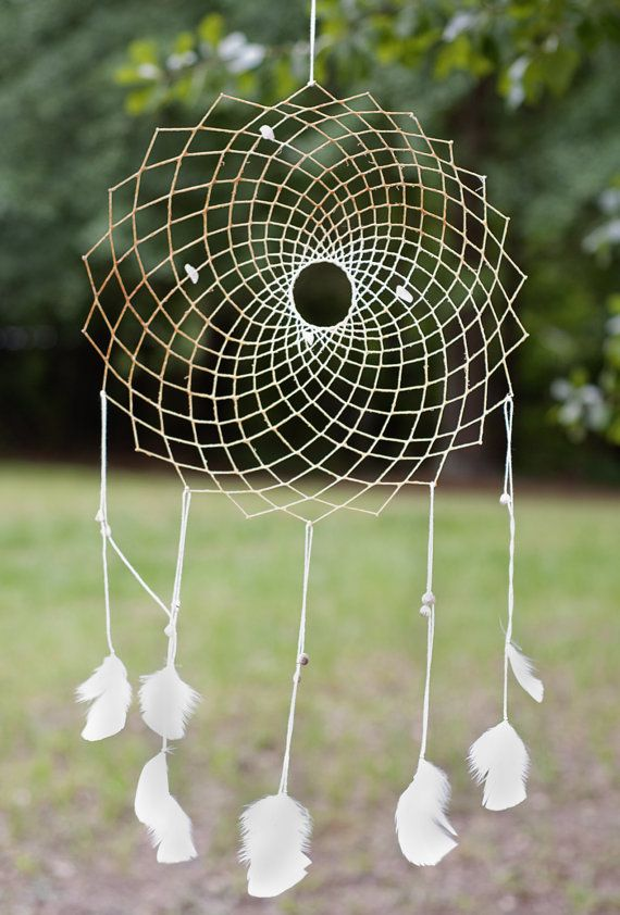 Stones: Rose Quartz & Seashell  Feathers: White Turkey  Size: 13    Rose Quartz is the stone of love and marriage, symbolizing universal love and