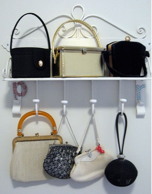 Love the fun look of these hooks for purses ~ BAGS STORAGE IDEAS cb8936335d6c9