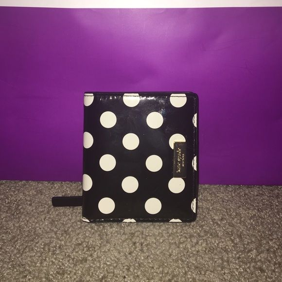 Kate Spade Small Stacy This is an authentic small Stacy wallet in black patent with white/cream polkadots. This has been used, but is in great condition. Has a few small marks on the front. ❌No trades!❌ kate spade Bags Wallets