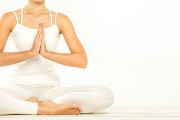 woman sitting in lotus position  anusara yoga lotus