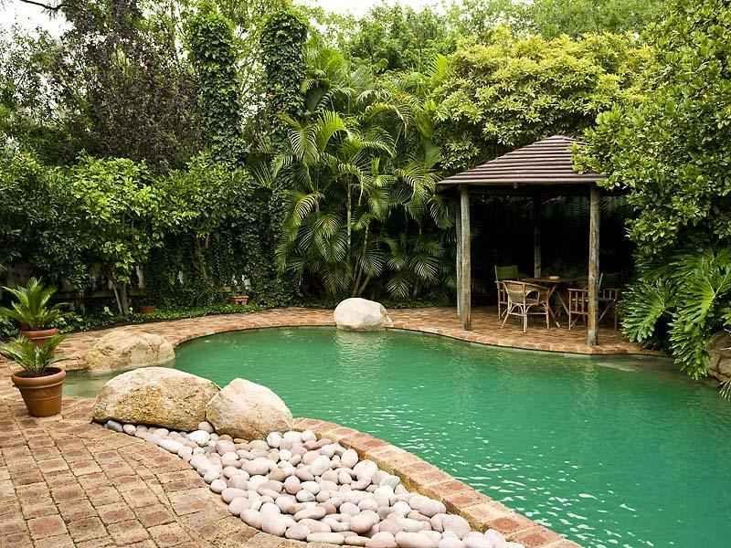 Tropical pool design using slate with gazebo rockery for Tropical pool gardens