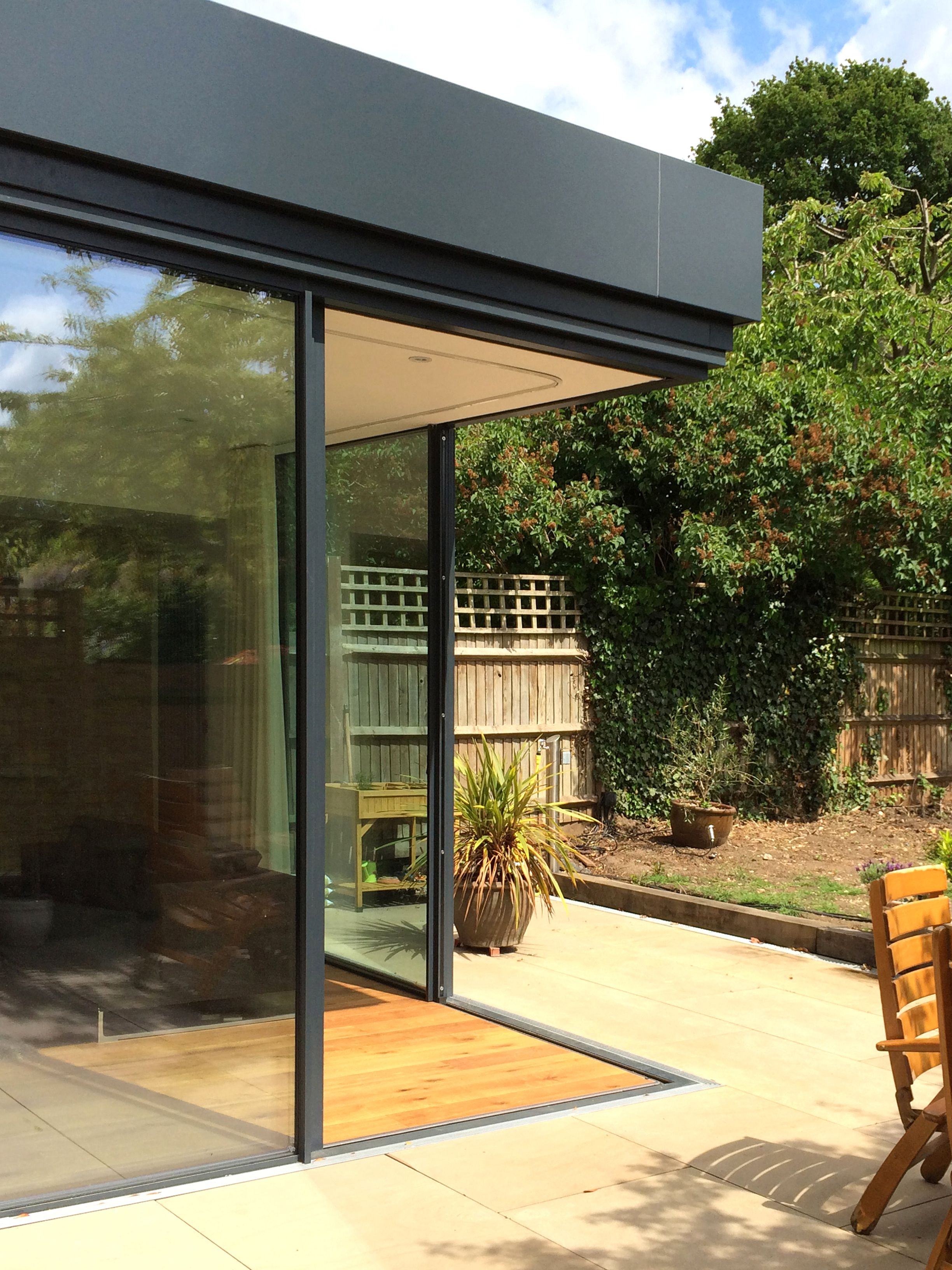 Open Corner Created With Minimal Windows Sliding Glass Doors | Richmond  Park | IQ Glass |
